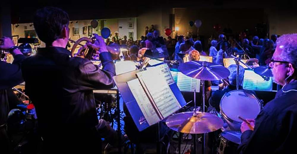 View of the crowd at a coorporate event from behind the Long Island Jazz Orchestra.