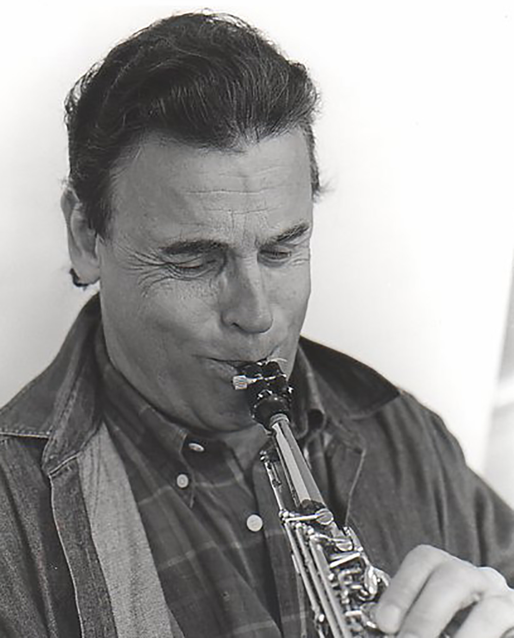 Mike Ficco enjoys playing a song on his soprano saxophone.