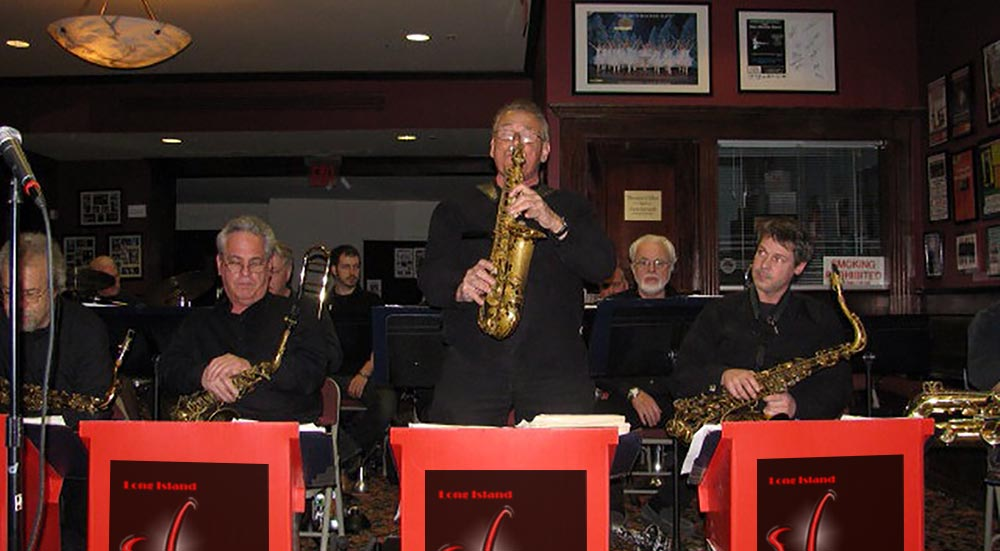 Saxophonist Mike Ficco taking a solo during a party performance.