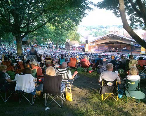 Attendees of an outdoor concert in Valley Stream, NY.